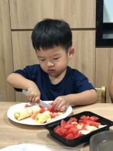 cooking at preschool cutting fruits